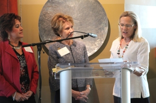 Suzanne Cisneros (Founding Member) and Kathy Elliott (Co-Chair Grants Committee) present a gift to Founder Susan Priem