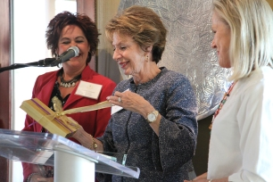 Suzanne Cisneros (Founding Member) and Kathy Elliott (Co-Chair Grants Committee) present a gift to Founder Susan Priem.